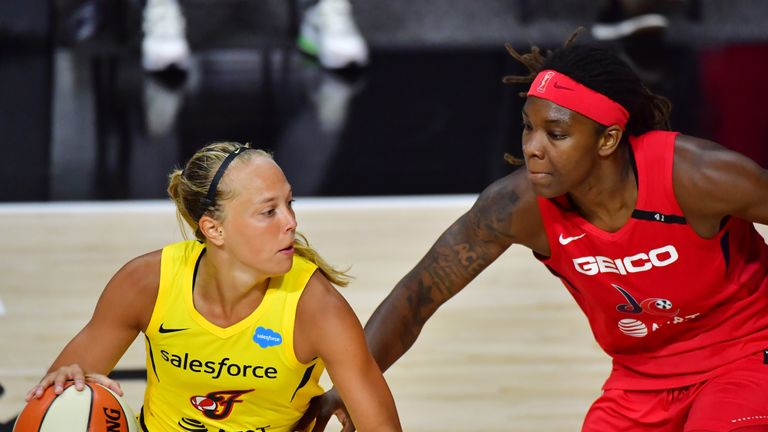 ulie Allemand #20 of the Indiana Fever looks to dribble around Myisha Hines-Allen #2 of the Washington Mystics during the second half of a game at Feld Entertainment Center on August 09, 2020 in Palmetto, Florida.