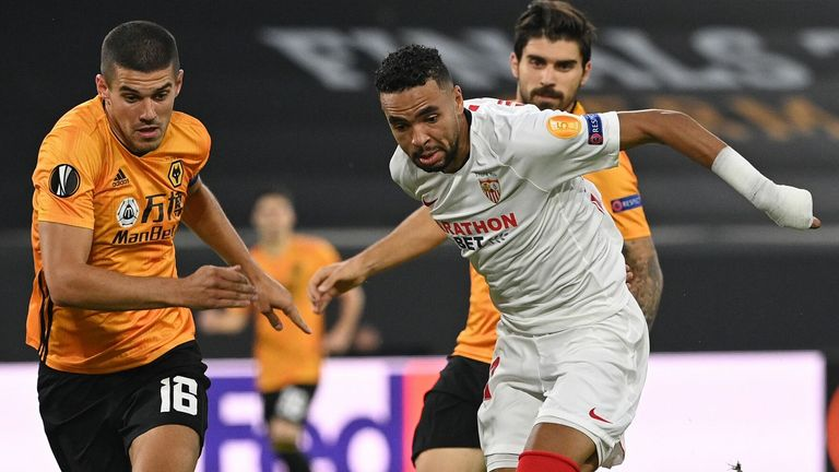Sevilla's forward Youssef En-Nesyri (R) vies with Wolves defender Conor Coady