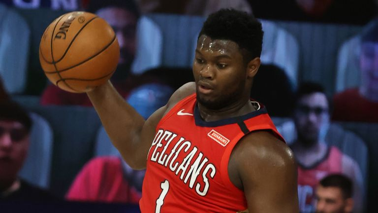Zion Williamson leaps to grab a rebound in the Pelicans' win over the Grizzlies