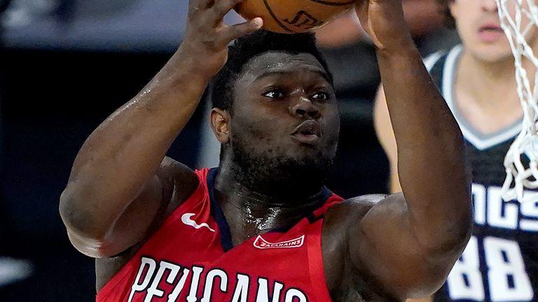 Zion Williamson rises to the rim to score against the Sacramento Kings