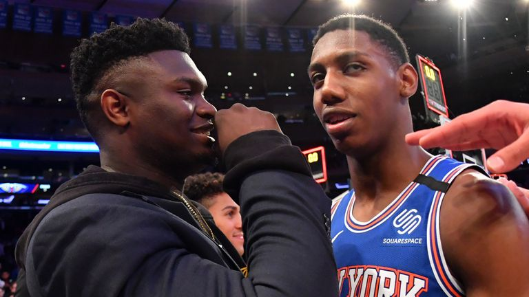 Zion Williamson shares a word with RJ Barrett before a Pelicans-Knicks game