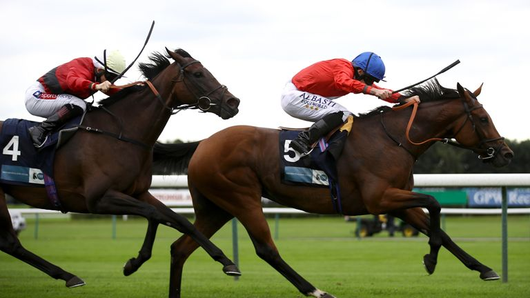 Veracious ridden by Ryan Moore (right) wins The BetVictor British EBF Dick Hern Stakes at Haydock Park