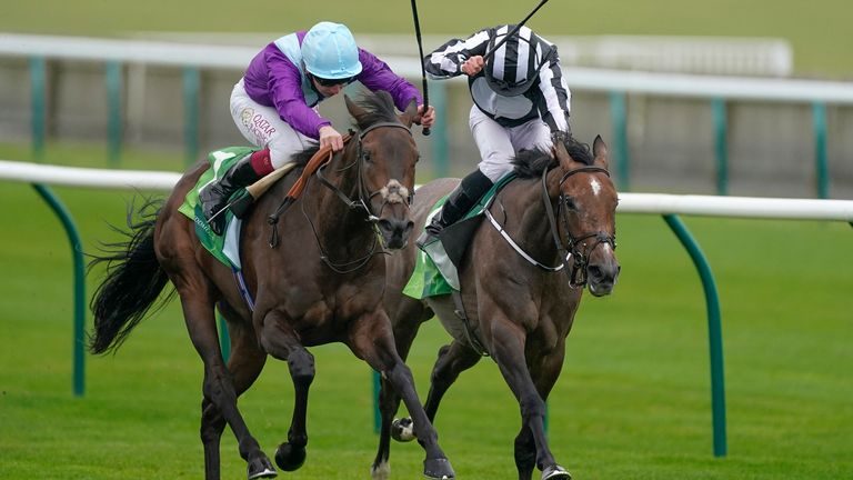 NEWMARKET, ENGLAND - SEPTEMBER 26: Oisin Murphy riding Alcohol Free (L) win The Juddmonte Cheveley Park Stakes from Ryan Moore and Miss Amulet (R) at Newmarket Racecourse on September 26, 2020 in Newmarket, England. Owners are allowed to attend if they have a runner at the meeting otherwise racing remains behind closed doors to the public due to the Coronavirus pandemic. (Photo by Alan Crowhurst/Getty Images)