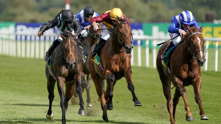 Chindit (left) wins the Champagn Stakes