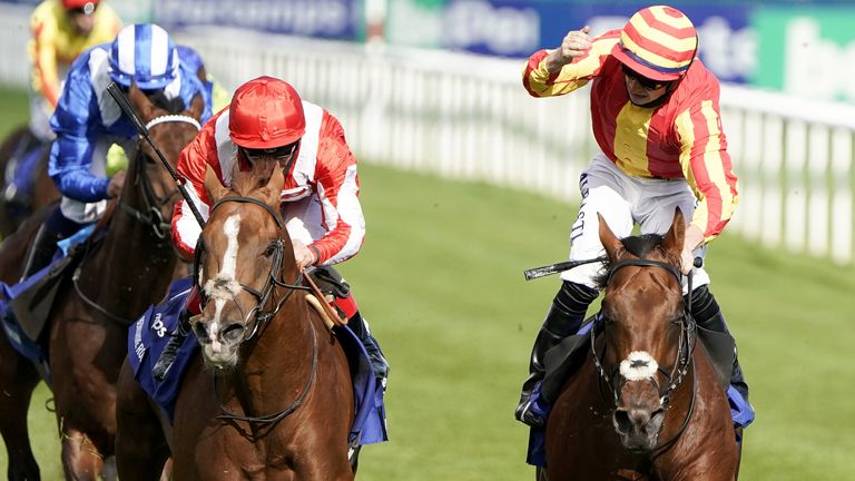 Galileo Chrome ridden by jockey Tom Marquand (right) winning the Pertemps St Leger
