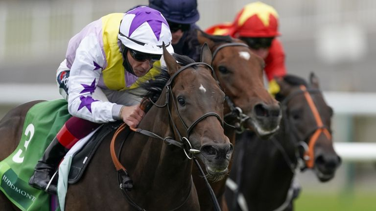 Frankie Dettori riding New Mandate (left) win The Juddmonte Royal Lodge Stakes from Ryan Moore and Ontario (centre) during day three of The Cambridgeshire Meeting at Newmarket Racecourse.