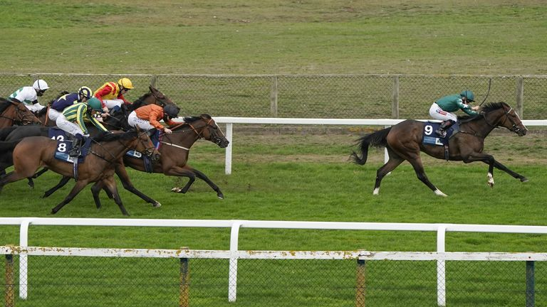Hollie Doyle riding Majestic Noor (right, green) win The EBF Stallions John Musker Fillies' Stakes at Great Yarmouth