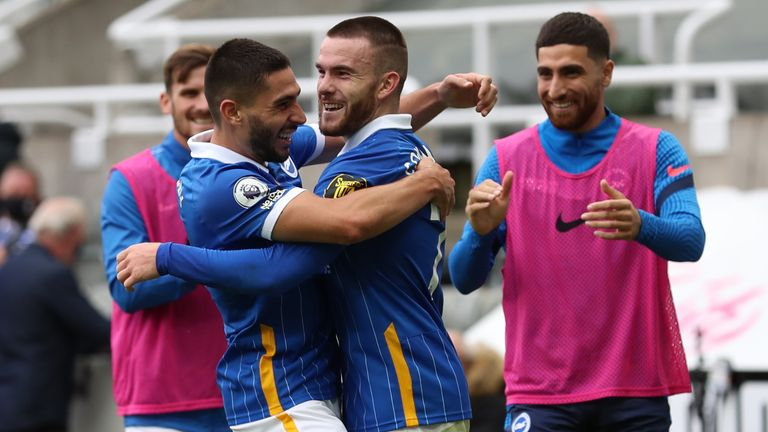 Aaron Connolly and team-mates celebrate after he puts Brighton 3-0 up at Newcastle