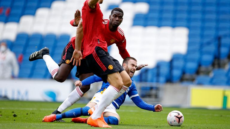 Aaron Connolly goes down inside the penalty area from a challenge by Paul Pogba