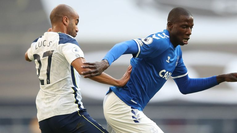 Abdoulaye Doucoure is closed down by Lucas Moura during the first half