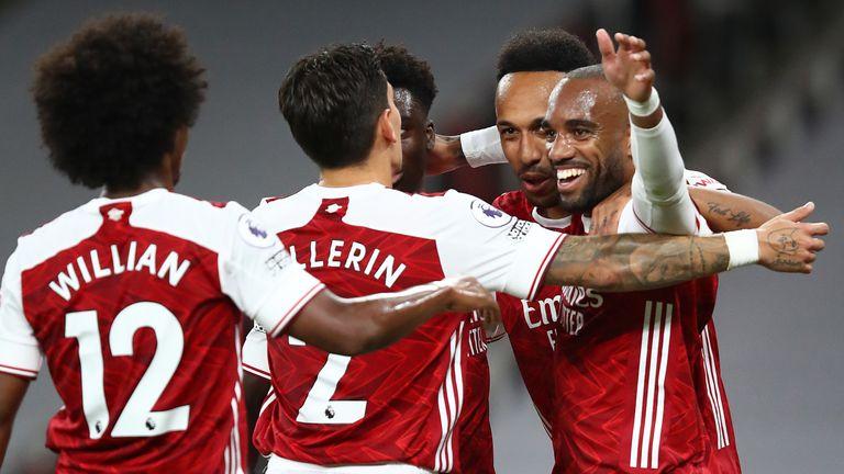 Alexandre Lacazette celebrates his goal with team-mates