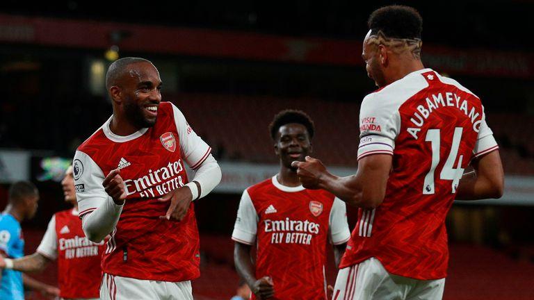 Alexandre Lacazette celebrates his goal against West Ham with Pierre-Emerick Aubameyang