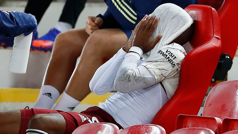 Alexandre Lacazette reacts after being substituted at Anfield