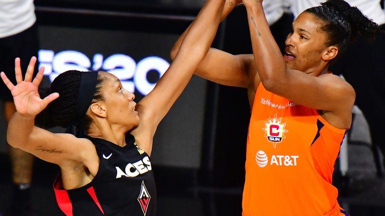 Alyssa Thomas fires a jump shot over 2020 MVP A'ja Wilson