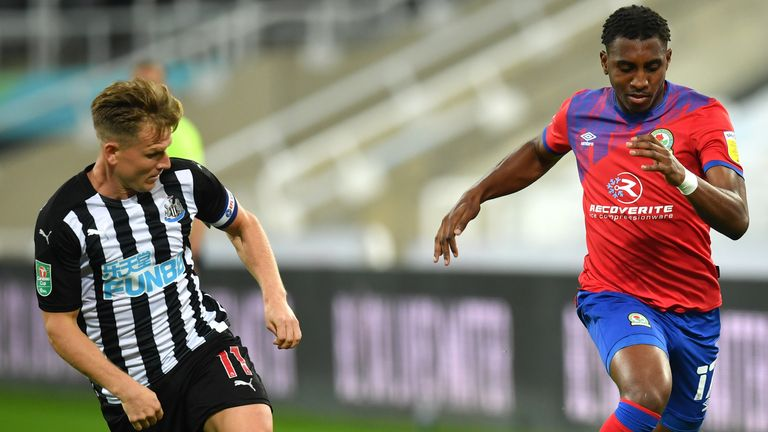 Matt Ritchie takes on Amari'i Bell at St James' Park