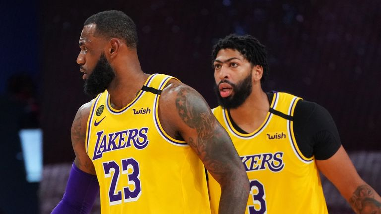 LeBron James and Anthony Davis line up on defense in the Lakers' Game 4 win over the Rockets
