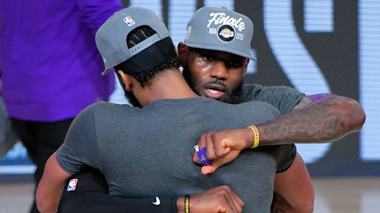 Anthony Davis hugs LeBron James at the conclusion of the Western Conference Finals