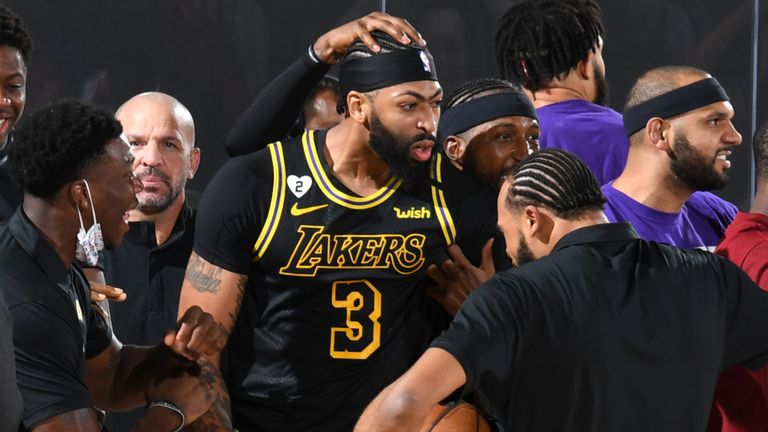 Anthony Davis mobbed by Lakers team-mates and coaches after hitting a game-winning shot in Game 2 of the Western Conference Finals