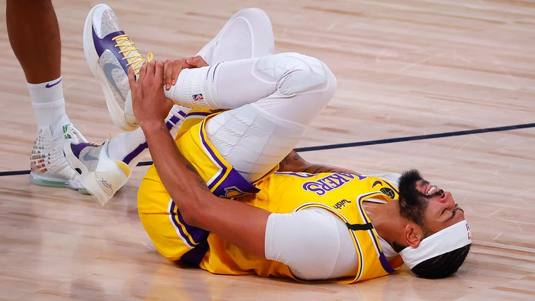 Anthony Davis writhes in pain after injuring his ankle in Game 4 of the Western Conference Finals
