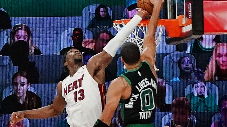 Bam Adebayo elevates to reject Jayson Tatum's attempted dunk at the rim