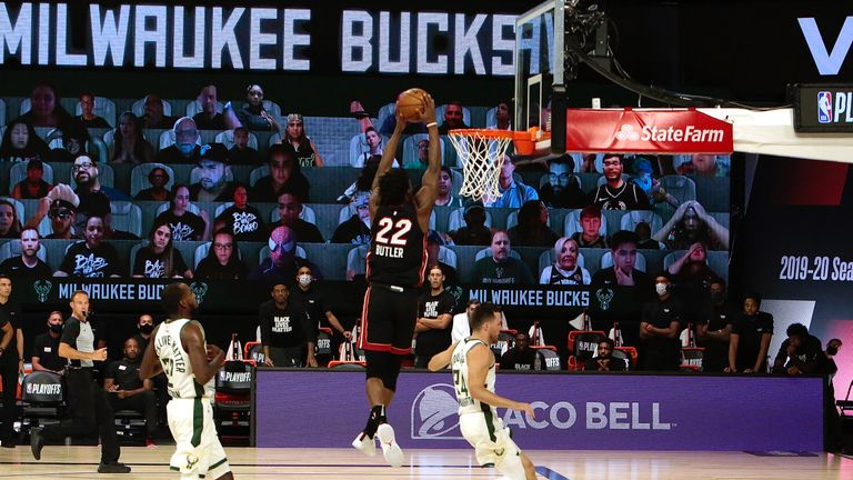 Miami's Jimmy Butler produced the steal before slamming home against Milwaukee in Game 5 of their Eastern Conference semi-final series.