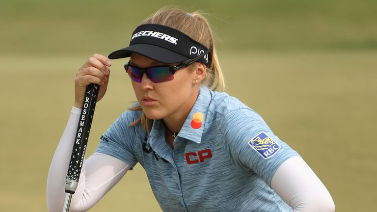 Brooke Henderson charged into the lead with a 65