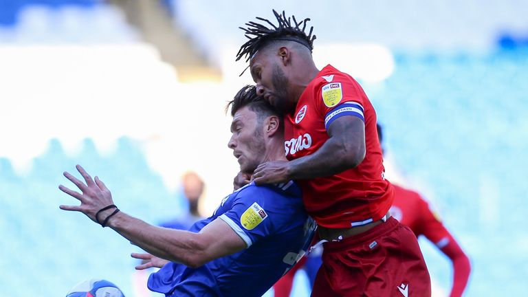 CARDIFF, WALES - SEPTEMBER 26: Kieffer Moore of Cardiff City FC and Liam Moore of Reading during the Sky Bet Championship match between Cardiff City and Reading at Cardiff City Stadium on September 26, 2020 in Cardiff, Wales. (Photo by Cardiff City FC/Getty Images)