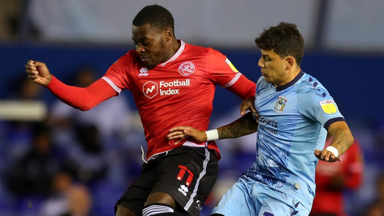 Bright Osayi-Samuel and Gustavo Hamer battle for possession during Coventry's match against QPR
