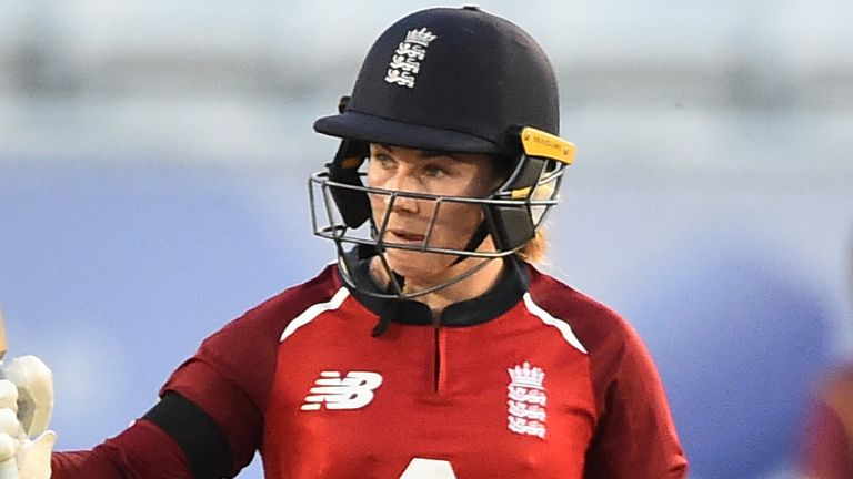 England's Tammy Beaumont raises her bat after reaching 50 in the first T20 against West Indies