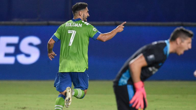 Cristian Roldan's double helped Seattle Sounders stay top of the Western Conference