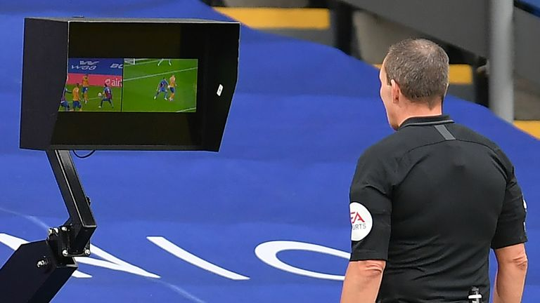 Kevin Friend uses the pitchside monitor