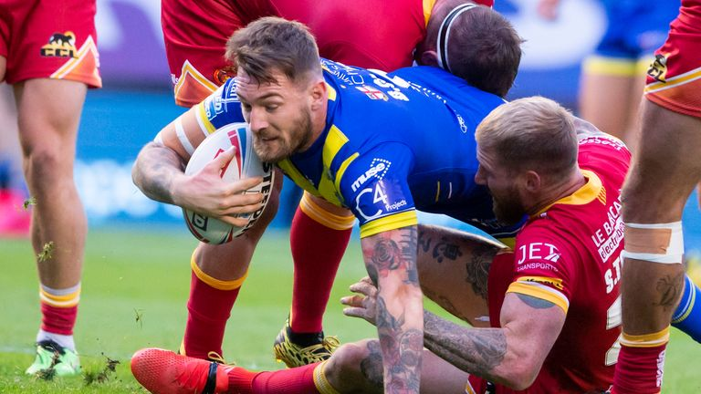 Warrington's Daryl Clark is tackled by Sam Tomkins