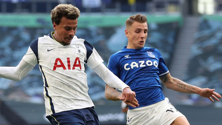 Dele Alli comes under pressure from Lucas Digne as he looks to get Spurs going