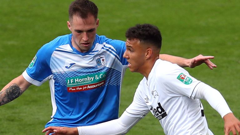 Lee Buchanan of Derby County competes with Josh Kay of Barrow during the Carabao Cup First Round match between Derby County and Barrow