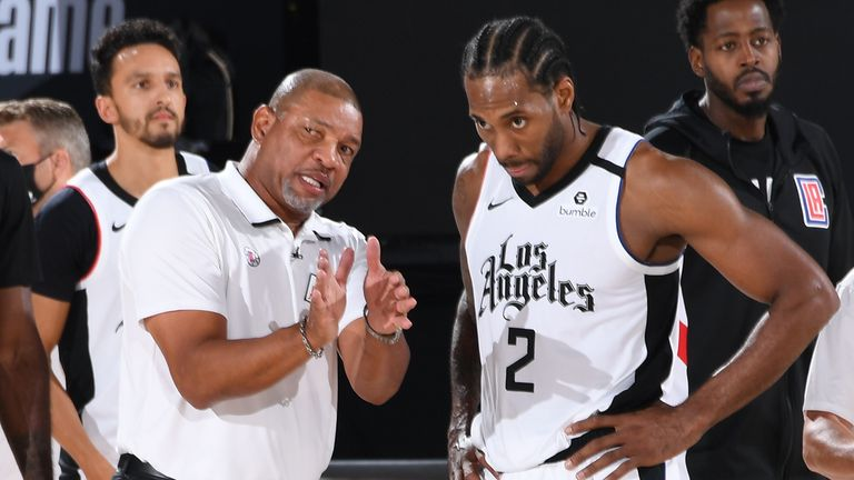 Head coach Doc Rivers talks with Kawhi Leonard of the LA Clippers during Game Three of the Western Conference SemiFinals