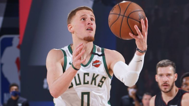 Donte DiVincenzo scores with a lay-up against the Miami Heat in Game 4
