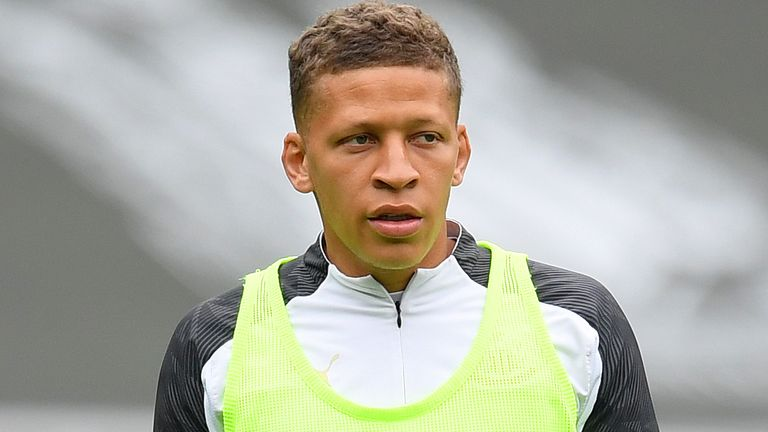 Dwight Gayle of Newcastle United warms up ahead of the Premier League match between Newcastle United and Tottenham Hotspur at St. James Park on July 15, 2020 in Newcastle upon Tyne, England. Football Stadiums around Europe remain empty due to the Coronavirus Pandemic as Government social distancing laws prohibit fans inside venues resulting in all fixtures being played behind closed doors.