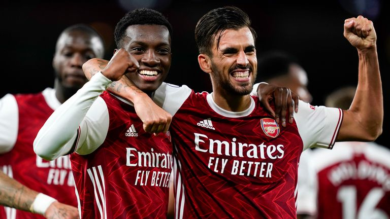 Eddie Nketiah celebrates with team-mate Dani Ceballos after scoring Arsenal's winner