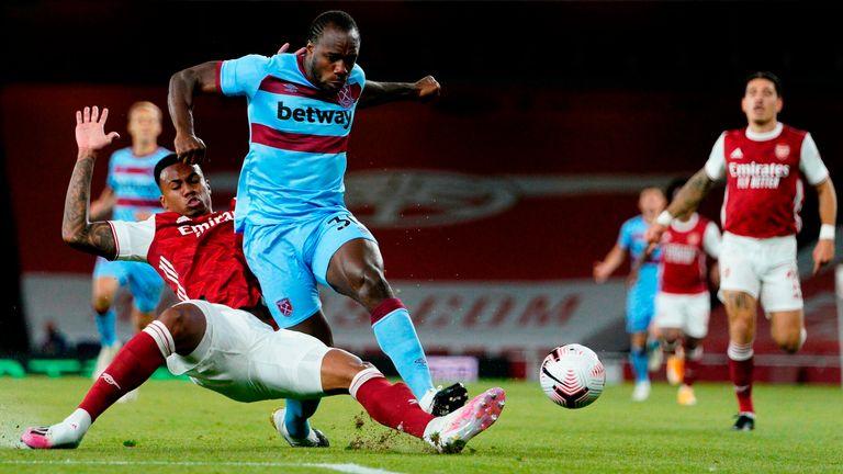 Arsenal's Gabriel tackles Michail Antonio of West Ham