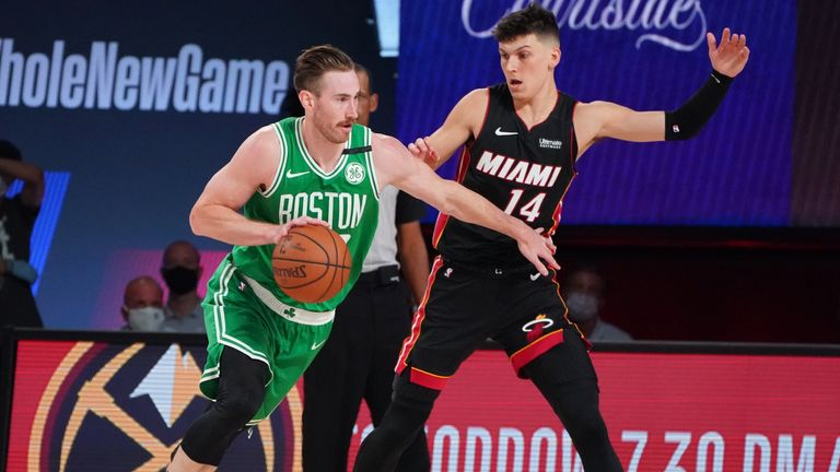 ORLANDO, FL - SEPTEMBER 19: Gordon Hayward #20 of the Boston Celtics handles the ball against Tyler Herro #14 of the Miami Heat during Game Two of the Eastern Conference Finals of the NBA Playoffs on September 19, 2020 at the AdventHealth Arena at ESPN Wide World Of Sports Complex in Orlando, Florida. NOTE TO USER: User expressly acknowledges and agrees that, by downloading and/or using this Photograph, user is consenting to the terms and conditions of the Getty Images License Agreement. Mandatory Copyright Notice: Copyright 2020 NBAE (Photo by Jesse D. Garrabrant/NBAE via Getty Images)