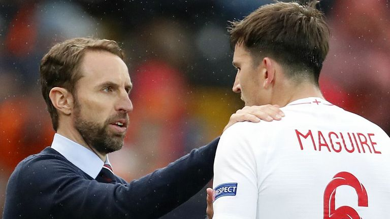 England manager Gareth Southgate speaks to defender Harry Maguire