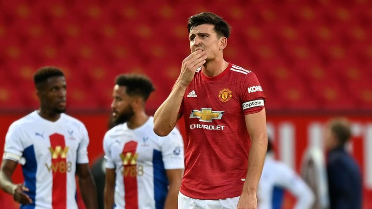 Harry Maguire cuts a dejected figure after Palace extend their lead