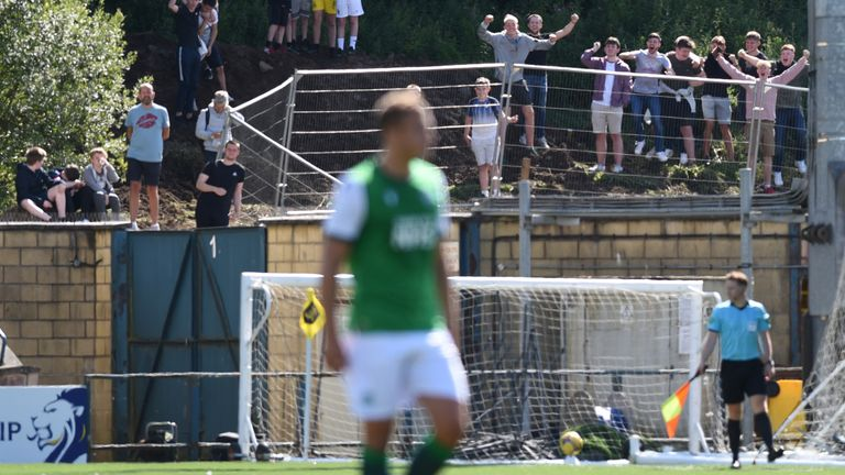 Supporters outside the Tony Macaroni Arena watch Hibernian in Premiership action at Livingstone