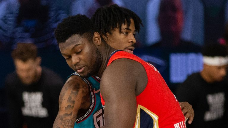 Rookie stars Ja Morant and Zion Williamson share a hug before a Grizzlies-Pelicans game