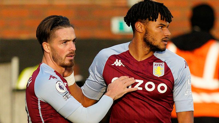 Aston Villa's English midfielder Jack Grealish (L) celebrates scoring the opening goal with Aston Villa's English defender Tyrone Mings during the English Premier League football match between Fulham and Aston Villa at Craven Cottage in London on September 28, 2020.
