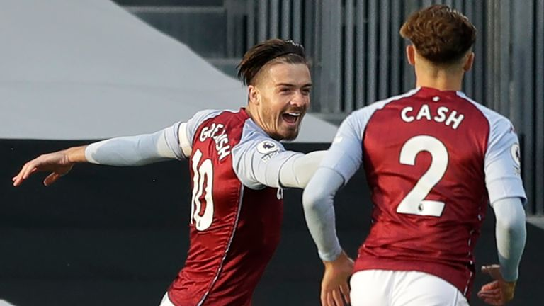 Jack Grealish of Aston Villa celebrates with team-mate Matty Cash after scoring his team's first goal during the Premier League match between Fulham and Aston Villa at Craven Cottage