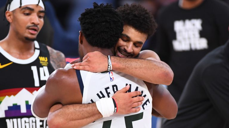 Denver's Jamal Murray hugs Jazz guard Donovan Mitchell at the conclusion of Game 7