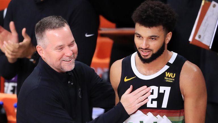 Nuggets coach Mike Malone  congratulates starting guard Jamal Murray