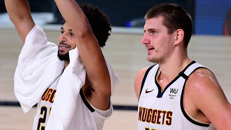 Jamal Murray and Nikola Jokic celebrate the Denver Nuggets' Game 7 victory over the LA Clippers