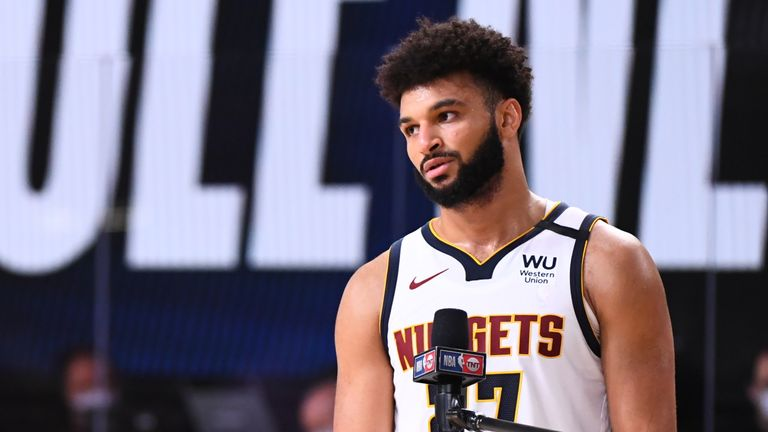 Rebecca Haarlow interviews Jamal Murray of the Denver Nuggets on the court after the game against the LA Clippers during Game Two of the Western Conference Semifinals